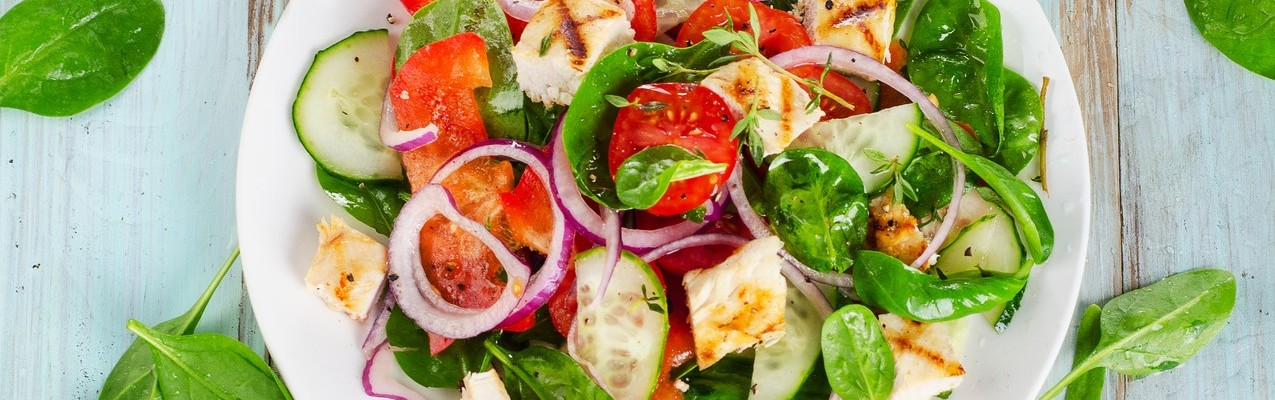 Healthy salad with grilled chicken breast. Top view